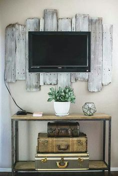 Cute Country back splash for the tv.  Old tobacco barn wood would look cool