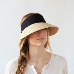 Stay cool and protected in the garden or on the beach with this wide-brimmed, raffia visor. Each visor is paired with a cotton band and Velcro strap for easy adjustment.