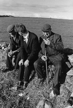 Three men stop for a chat and a smoke, Ireland, 1974.