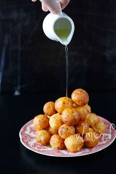 Almond Corner: Ricotta fritters with rosemary-orange syrup