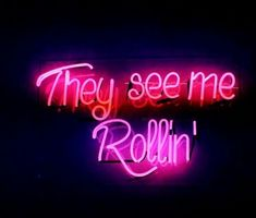 """image description: pink, red, and purple neon sign reading """"they see me rollin'"""" Neon Wallpaper, Aesthetic Iphone Wallpaper, Aesthetic Wallpapers, Photo Wall Collage, Picture Wall, Neon Quotes, Neon Words, Neon Light Signs, Custom Neon Signs"""