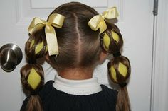 I think this is cute, but with smaller eggs. Crazy Hair and more Hairstyles from CuteGirlsHairstyles.com