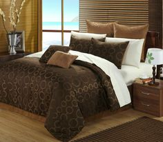 OVERSIZED AND OVERFILLED. The heaviest quality Jacquard fabric on the market. The simple yet elegant brown and gold pattern contemporary yet sophisticated. Overfilled gives you a plush look. Detailed quilted throw pillows feel like its custom made. Adding a bonus 200 thread count cotton sheet makes this a value that is unbeatable. We like to call them SUPER BEDDING SETS. 4 Elegant dcor pillow combinations give you many alternate looks you can achieve with just this one set.