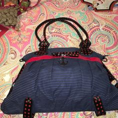 Brand new, never used ironfist nautical purse Brand new navy, black, & red nautically style purse with anchor embellishment. Iron Fist Bags