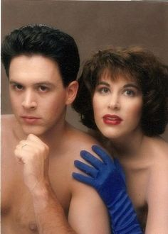 Hot Glam Couple It looks like she is getting ready to scrub the toilet in rubber gloves