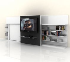 The Poppi Theatre Space Saving System consists of a twin wall bed beside book/media shelf with a large sliding door on the front designed to mount a flat screen TV.