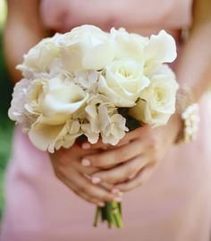 All-white bouquets of roses, hydrangeas and calla lilies were simple and chic.