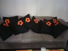 Dark brown and orange on the reverse side with cute orange hand-made flowers.