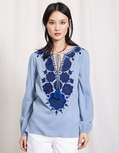 This floaty top in cool, lightweight cotton is intricately embroidered and just begging for sunshine and lazy picnics. A relaxed fit with blouson sleeves and tassel trims only adds to the effortless bohemian style.