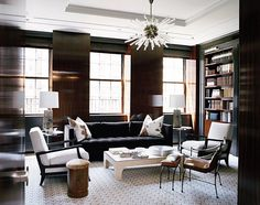 love the sputnik chandelier and the warmth of this room