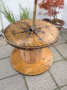 cable spool tables Cable spool repurposed with compass and yacht varnish Cable spool repurposed with compass and yacht varnish Diy Cable Spool Table, Cable Reel Table, Wood Spool Tables, Wooden Cable Reel, Cable Spool Ideas, Large Wooden Spools, Wooden Cable Spools, Wire Spool, Electrical Spools