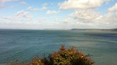 Halfway down the stairs if you look north and squint really hard you can see Wales! :-)
