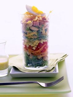 Chef's Garden Salad Layer colorful vegetables with beans, cheese and bacon for this main-dish salad. Serve it in a clear-glass bowl at parties so guests can see the layers.