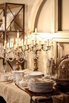 Beautiful soft white, sparkly candelabra, glass, white dishes, rustic wood and metal. Lovely!