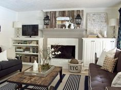 Reclaimed barn wood provides the ideal accent for the white painted fireplace and gray mantle in this cottage-inspired living room. Custom cabinetry flanks the fireplace and carriage lights are installed above the mantel for a true design statement.