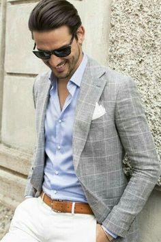 Summer suiting inspiration with white pants brown leather belt blue button up shirt gray and white window pane blazer with a white pocket square black sunglasses Mens Fashion Suits, Fashion Outfits, Fashion Top, Fashion Wear, Mens Suits, Street Fashion, Terno Casual, Blazer Outfits Men, Look Man