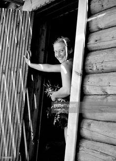 Smiling woman going into a Finnish sauna - undated- Photographer: Presse-Illustrationen Heinrich Hoffmann- Vintage property of ullstein bild