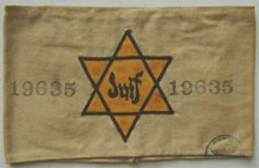 """France, white armband with yellow Jewish star with inscription """"Juif"""" (""""Jew"""") 1935-45"""