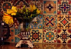 Would love a few of these bright beautiful tiles mixed in with more muted ones for a backsplash in the kitchen