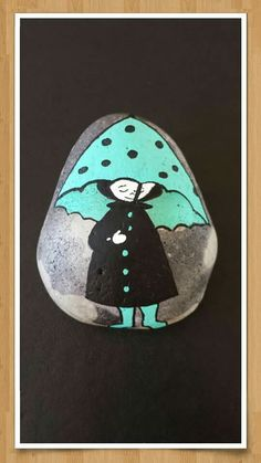 Walking girl in rain painted rock