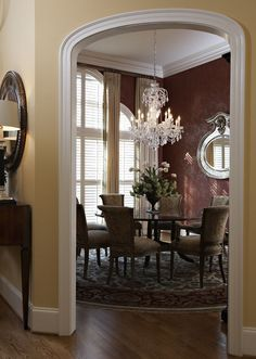 burgundy dining rooms   Burgundy and cream formal dining room - awesome chandelier!