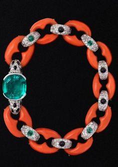 rubies.work/… Circa 1922 Cartier coral, diamond, onyx, and emerald bracelet.