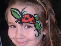 Pretty ladybug face paint.