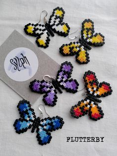 Pixelated Flutterby earrings made of Hama Mini Perler Beads for butterfly lovers! by SylphDesigns Hama Mini, Mini Hama Beads, Diy Perler Beads, Perler Bead Art, Fuse Beads, Pearler Bead Patterns, Perler Patterns, Art Perle, Motifs Perler