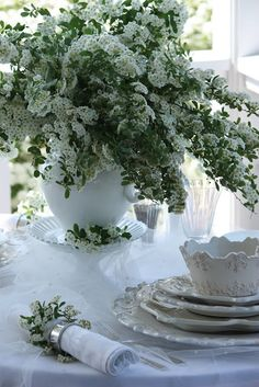 Heavily detailed  white and ivory ironstone dishes, pearl studded tulle & bridal veil flowers.