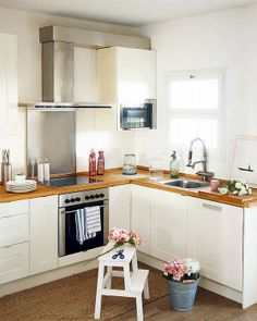 perfect kitchen style for a getaway cabin… a little country but not too much. #kitchen