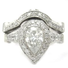 Pear shape diamond engagement ring and band bezel set by KNRINC, $4099.00