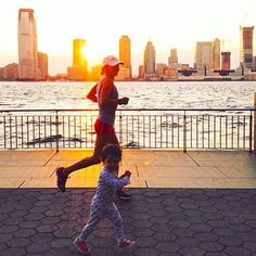 Welcome to #RunnerLand  #Photo: @athletestyle  Easy evening jog with a little future racer #NYC #sunset