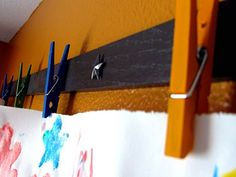 Where was this cute idea 3 kids ago? Beats artwork stuck to the refrigerator! Great way to display these treasures!