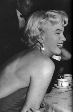 Marilyn at the wrap party for The Seven Year Itch in November 1954. Photo by Sam Shaw.
