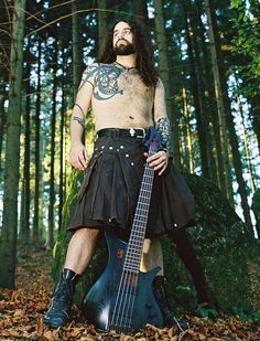 THE KILTED HOTTIE OF THE DAY Did you know there is a subgenre of metal music known as Celtic metal? Yep(there's also pagan and Viking metal), and our hottie used to be the bass player for Eluveitie(el vay ti), a Swiss Celtic metal band. His name is Rafi Kirder--he left the band in 2008 and now plays with another Celtic metal band, Red Shamrock. I guess you could say he LITERALLY rocks the kilt.