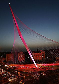 AP Photo/Tara Todras-WhitehillThe light rail bridge designed by Spanish architect Santiago Calatrava is seen lit up in pink for breast cancer awareness in Jerusalem, Monday, Oct. The bridge is one of over 200 landmarks worldwide lit up. Santiago Calatrava, Hoboken Restaurants, Terra Santa, Bridge Design, Light Rail, Comme Des Garcons, Holy Land, Covered Bridges, Tel Aviv