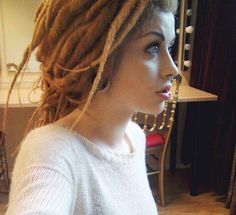 She has the dreads I want, her septum pierced and her vertical lebret and stretched ears. She's like everything I want XD