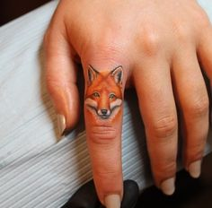 Fox tattoo. Not on my finger, but I love the size.