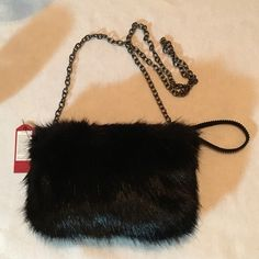 """Shop Women's Boutique Black size See Description Clutches & Wristlets at a discounted price at Poshmark. Description: Black Soft Plush Faux Fur Wristlet Cross Body Bag. 9""""x6.5"""". Inside pocket. Zip top closure. 48"""" Black Chain and Wristlet Strap. Sold by bitofheaven. Fast delivery, full service customer support."""