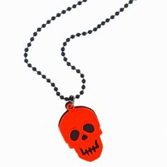 Orange skull longline necklace on a black bead chain Available from www.skullaccessories.co.uk