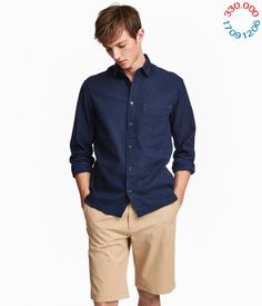 df38d3ca Shirt in indigo-dyed, denim-look cotton twill. Narrow turn-down collar,  chest pocket, buttoned cuffs and a rounded hem. Regular fit – a classic fit  with goo