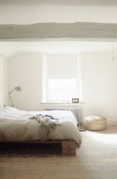 White bedroom - love the grey beam