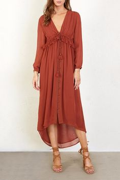 Chan Luu Ruffled Paprika Dress. This is a crafted from viscose georgette, this charming long sleeve midi dress offers a stunning silhouette that accentuates any figure.affiliate