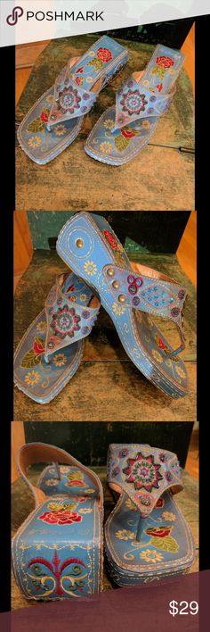Molly H Embroidered and Sequined Sandals A fabulously fun pair of shoes! Wonderful blue color base showcases the workmanship of embroidery accented by sequins. Gold rivets round out the details. These are a work of art for your feet! Worn only once. Molly H Shoes Sandals