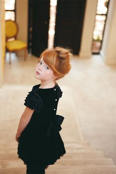 little redhead girl in a black dress.    Miss Mary Mack?