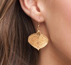 These super lightweight and gorgeous earrings consist of REAL LEAVES that have been dipped in either 24K gold or sterling silver. They will all vary just a touch in shape and size due to the vary nature of them, but all will look VERY similar to the ones shown as we are extremely choosy about the leaves that we select for your jewelry. All leaves will measure approximately one inch in size, bringing the total earring length to about 1.5 inches. ~Sterling silver version will consist of si...