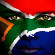 South African flag's colours, painted on the face of a youtful citizen and patriot.