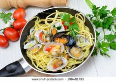 italian traditional food composed by spaghetti pasta and seafood fasolari,clams and mussels by enzodebernardo, via Shutterstock