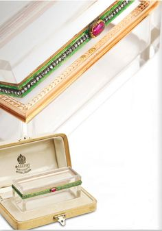 Fabergé rectangular gold-mounted and beveled crystal snuffbox, workmaster Henrik Wigström, St Petersburg, 1896-1908. The mount enameled translucent green and set with rose diamonds, with ruby pushpiece. Purchased by the Grand Duchess Xenia Alexandrovna on 9 August 1908 for 275 roubles.