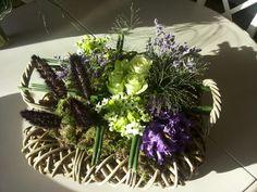 Arrangement on floral foam using moss, roses, ornitogalum,  pennisetum (millet), limonium.